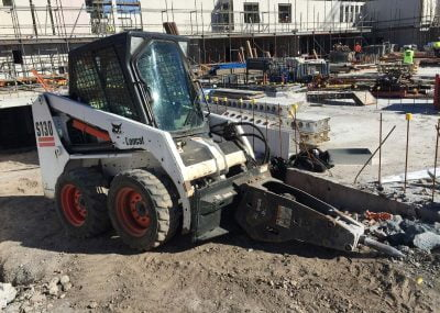 Bobcat with breaker attachment